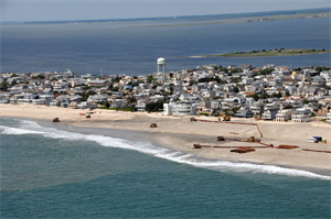 An aerial photograph captures contractors completing the Brant Beach storm damage reduction project in 2012. The beachfill work is designed to reduce storm damages to the community and infrastructure.
