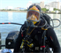Fully geared up, Steve England of the USACE Forward Response Dive Team prepares to enter the water beginning his structural inspection dive at Naha Military Port in Okinawa, Japan.