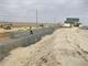 The U.S. Army Corps of Engineers Philadelphia District completed construction in March of 2013 on the East Point Shoreline Protection Project in NJ. Work involved excavating the area, placing marine mattresses, and positioning gabion baskets (cages filled with rocks) on top of the mattresses and sediment.